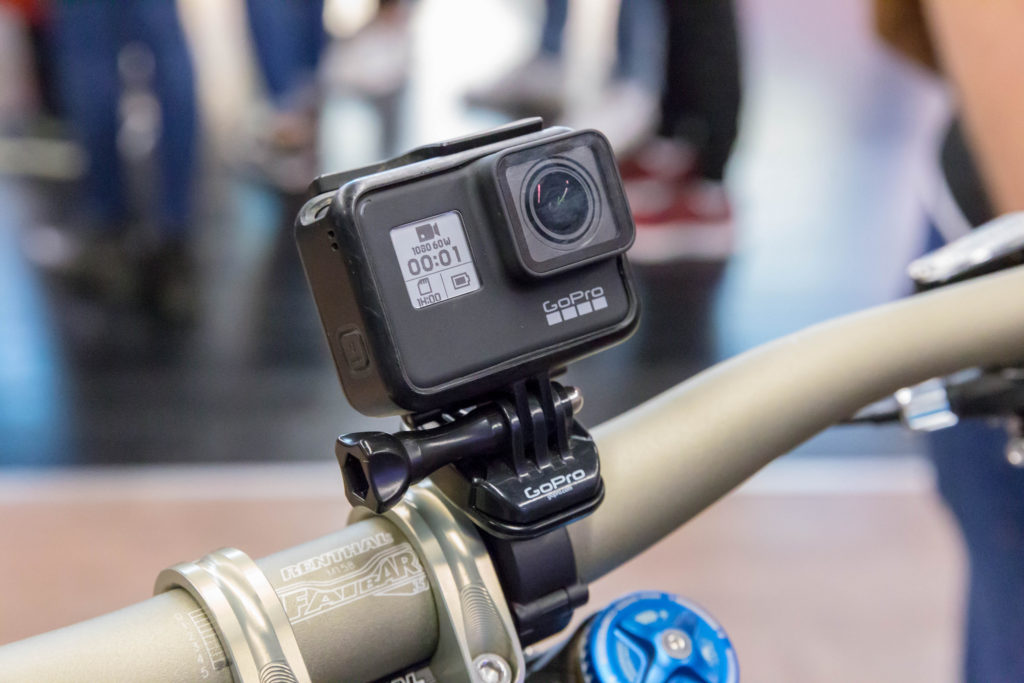 The GoPro Hero Seven Black mounted to a mountian bike ready to take voice commands while the user can keep both of their hands on the handlebars.