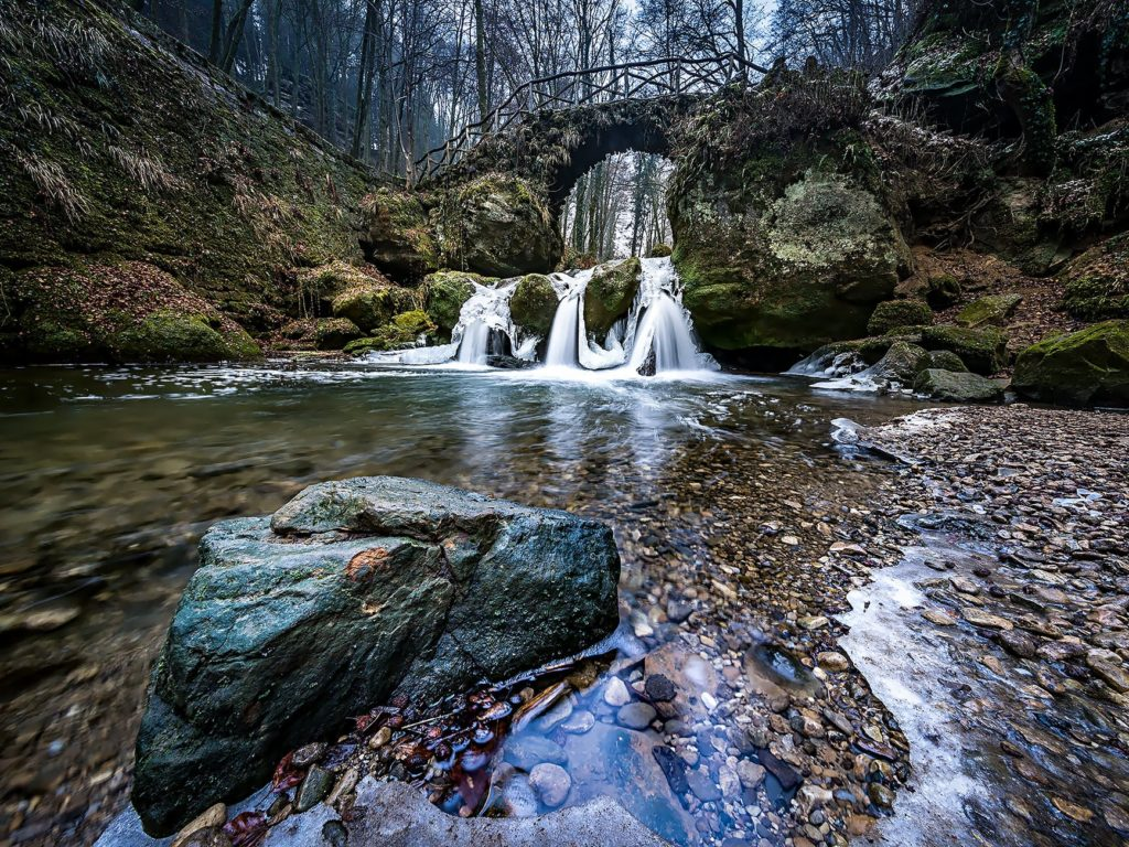 A phtoograph taken using an ND filter to allow the photographer to use an extended supper timer to capture the smooth milk look on the water of the waterfall.