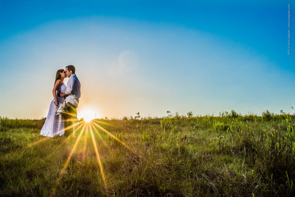 A wedding photograph that has been captured using a 35mm lens showing the mix between the wedding aspect and landscape aspect of the venue.