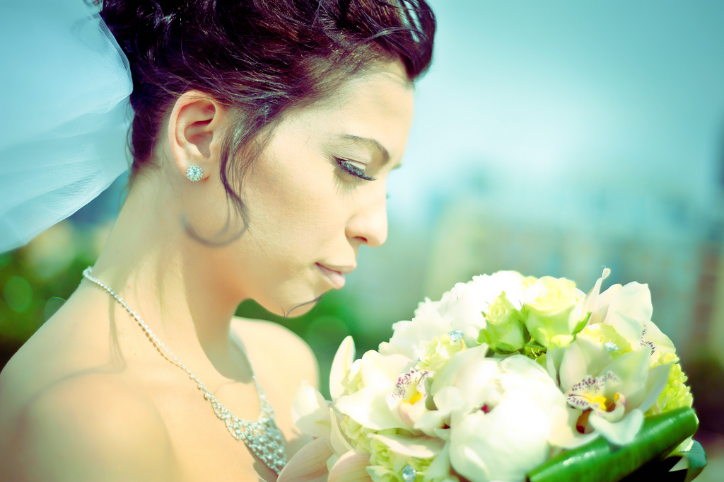 A great wedding photograph featuring the bride and her flowers captured using a Nikon 70-200mm f/2.8G.