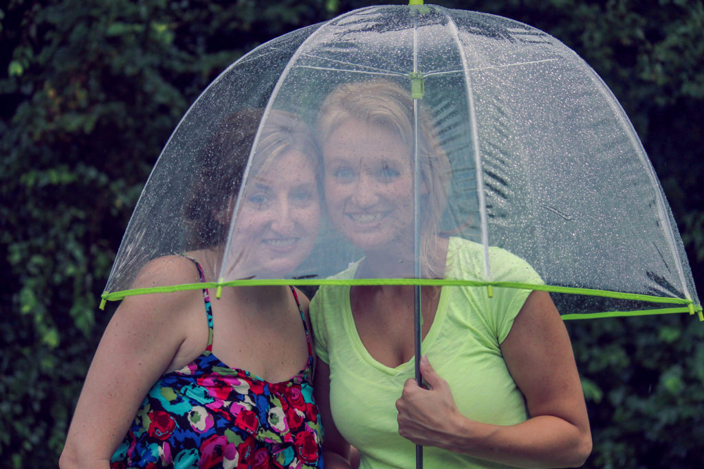A photograph captured at a wedding where the rain had unfortunately decided to fall on the big day.