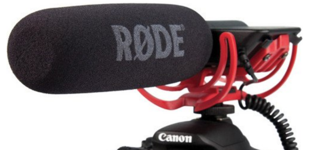 The Rode Video Mic mounted on the hot shoe mount of a Canon camera showing its Rycote Lyre Mount and Windbuster.